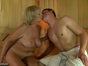 Busty grandma fucking with boy in the sauna