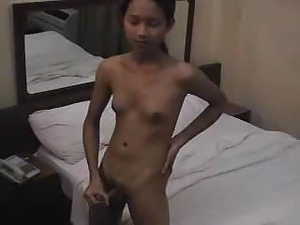 Skinny Thai shemale masturbates wildly in front of friend's camera