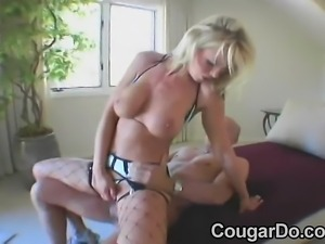 Hot blonde cougar with big tits loves to ride a hard di