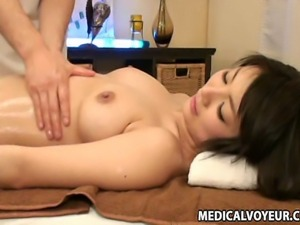Young Bride  during a bridal salon relaxation massage. She even lets the...