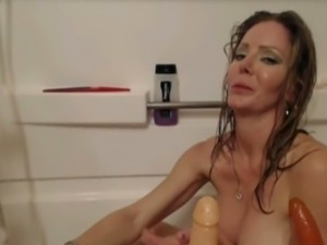 Hot blonde toying while bathing