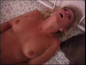 Mature blonde with nice tits sucks cowboys dick