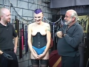 Hot BDSM goth chick gets ass spanked with spiked paddle till bloody by two studs