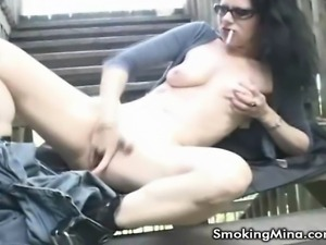 Slutty MILF Mina is a smoker and a rubber. She moves out onto her outdoors...