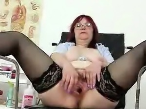 Redhead huge boobies cougar spreads her haired piss hole