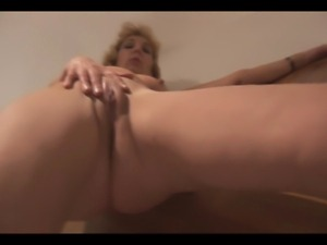 Attractive Mature lady stripping and showing off nice p