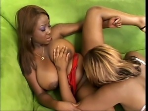 Busty black chicks eat cunt in the green couch