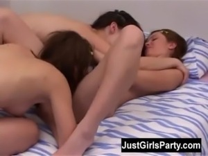 Three brunette teens playing with their toys in a bedroom free