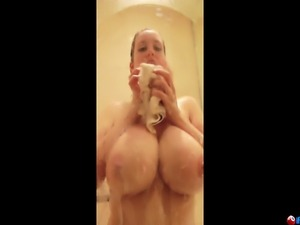 Blonde with Huge Boobs shows them and her nice ass off while taking a shower