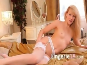 brutally sexy blonde in bedroom