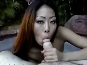 Asian babe in bikini smoking at pool