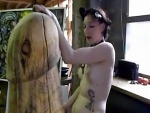 Goth girl fucks giant wooden cock