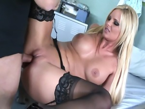 Busty blonde getting fucked in thigh high stockings a garter and high heels