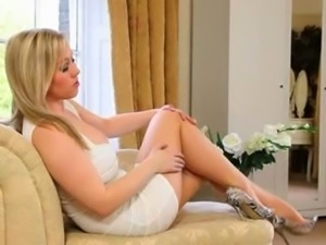 lovely blonde bride teasing on sofa