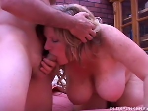 Gorgeous older babe with lovely large boobs fucks a lucky younger guy who...