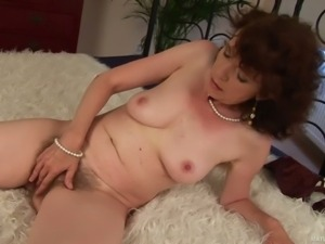 Good looking mature teacher Evelyn gets fucked by one of