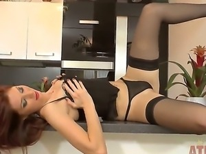 Kattie Gold shows her sexy body in amazing lingerie and masturbates with a dildo