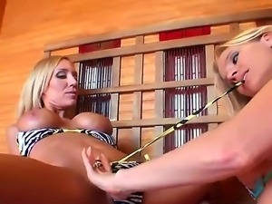 Sexy blonde bitches Brianna Ray and Toni are oiling up each others bodies and...