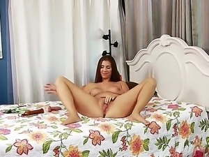 The attractive babe Alex Chance caresses her tits and masturbates her shaved...