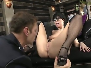Bespectacled beauty Emylia Argan is getting her twat licked hungrily by Rocco...