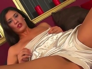 Gorgeous brunette Diana Stewart sucks her finger and masturbates in her warm bed