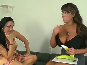 Mature busty bitch is teaching a younger one how to give really good blowjob