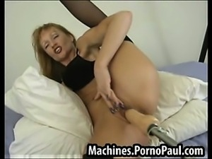 Flexible milf fucked by machines