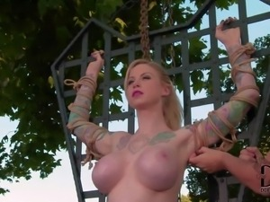 Topledd tattooed slave girl Hollie Hatton shows off her huge