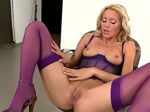 Fantastical blonde Sophie Moone in super sexy lingerie poses and rub herself...