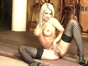 Enjoy delicious spicy blonde sex doll in nice black stockings getting herself...
