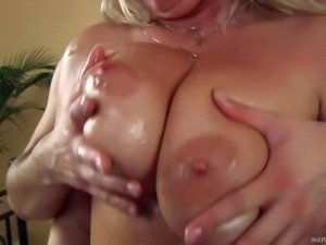 Blond mature woman Gitte with wet huge natural tits gives