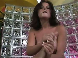 Busty babe Penny Flame enjoys pleasing hunk with amazing handjob session