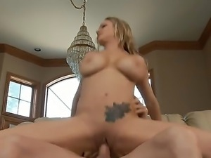 Briana Banks is a first-class blonde porn star with huge round boobs and...