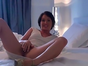Evelyn Lacie is an attractive, slender brunette who enjoys spreading her soft...