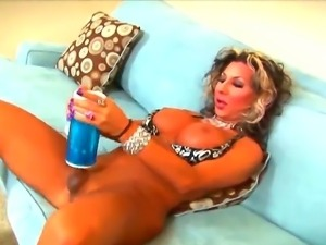 Sexy shemale with big boobs and a big stiff cock uses a pocket pussy to...