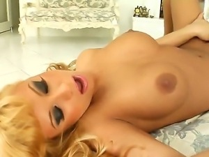 Adorable blonde goddess Dorothy with smoking hot body and dark heavy make up...