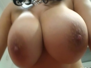 Sexy secretary Shione Cooper playing with her massive big tits and shows off...