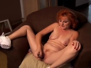 Gorgeous ginger cougar talks dirty and fucks her wet pussy until its squirting