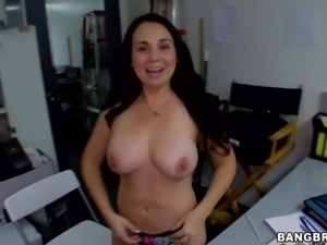Good looking amateur brunette milf Holly West with big natural knockers and...