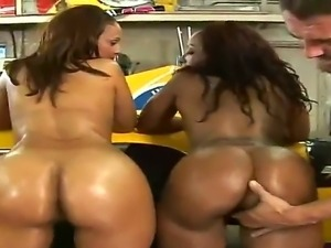Lusty cock hungry black hookers Cherokee and Mia with big tits and enormous...