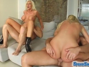 Skanky busty blondes share the (cum) load
