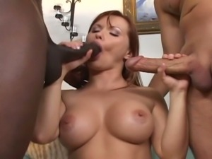 Red head milf takes black and white cocks