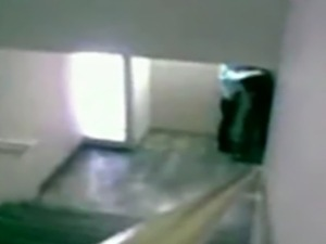 Couple having fun in the staircase, filmed secretly