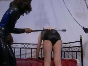 Attractive slave girl in latex loves pleasuring her horny master