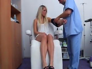 Young Blonde girl visits her gynecologist. Complete body check-up with great...