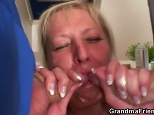 Busty blonde mature gets banged by two studs