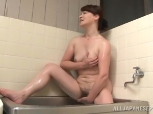 japanese milf plays with herself in the tub