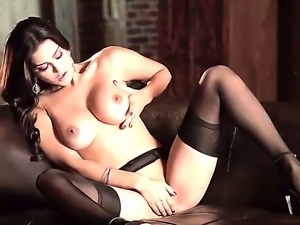 Dark haired babe Sunny Leone with big juicy boobs and stunning beautiful face...