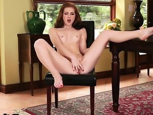 Natalie Lust with small tities and bald twat gives a closeup of her vagina as...