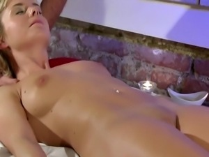Masseur fingers blonde babe beauty in this high def video